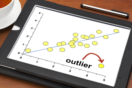 outlier or outsider concept on a digital tablet with a cup of te